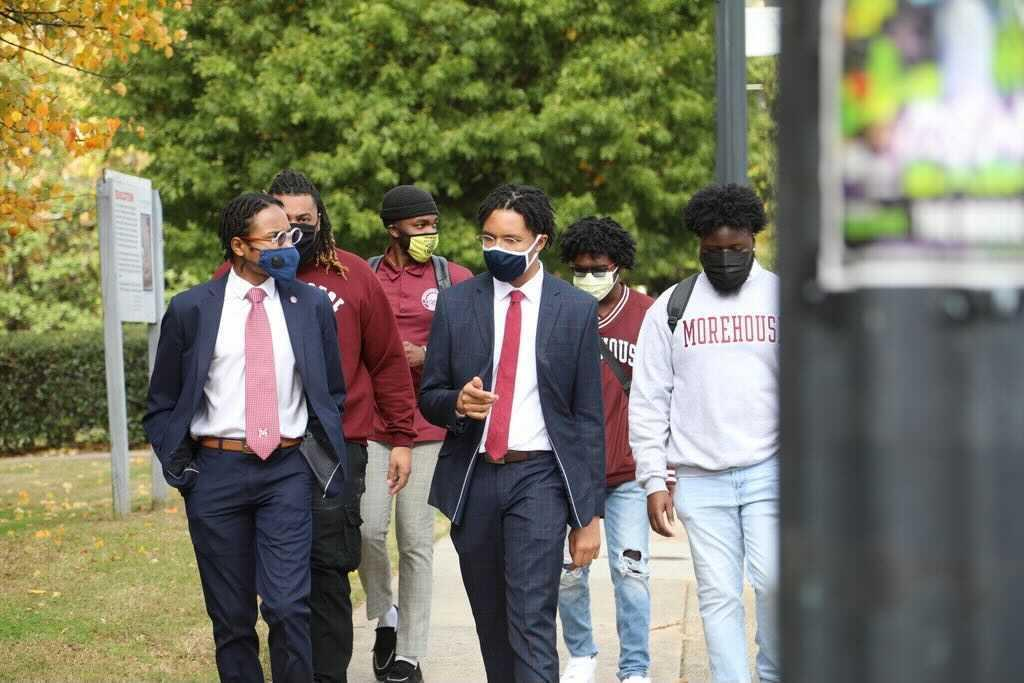 students walking with facemasks